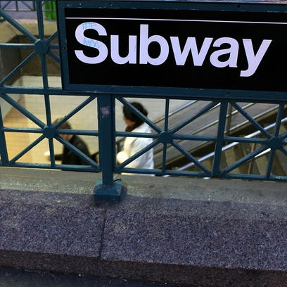 People enter the subway at Union Square in New York