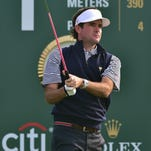 US Team player Bubba Watson tees off on the first hole during a practice session ahead of the 2015 Presidents Cup at the Jack Nicklaus Golf Club in Incheon, west of Seoul, on October 7, 2015. AFP PHOTO / JUNG YEON-JE RESTRICTED TO EDITORIAL USE - STRICTLY NO COMMERCIAL USEJUNG YEON-JE/AFP/Getty Images