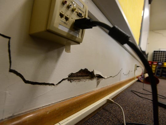 The plaster walls of classroom at Longfellow Elementary School are severely cracked.