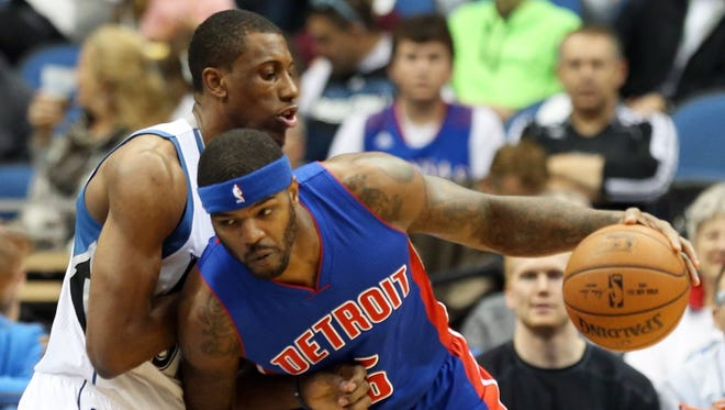Detroit Pistons' Josh Smith. right, drives around Minnesota Timberwolves forward Thaddeus Young in the first quarter of an NBA basketball game, Thursday, Oct. 30, 2014, in Minneapolis.