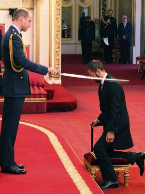 Former Beatle Ringo Starr, is made a knight by Britain's Prince William at Buckingham Palace during an Investiture ceremony in London Tuesday March 20, 2018.