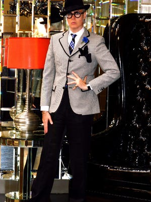 """New York dandy Patrick McDonald wears a Christian Lacroix suit, hat by Rod Keenan, Paul Smith shoes and Selima Optique eyeglasses that were named for him, """"The Dancy,"""" during an afternoon at the Riviera Resort and Spa in Palm Springs."""