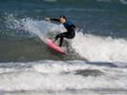 Coral Schuster, 13, is a local surfer who will be taking