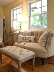 Neutral furniture, antiques, and colorful accents enhance the craftsman styl.jpg