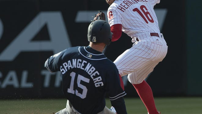 Phillies Cesar Hernandez, right, get the out and second base on San Diego Padres, Cory Spangenberg in the bottom of the 7th inning in the 2016 opening game at Citizens Bank Park, Philadelphia.