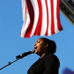 Fort Myers Police Officer Yvetta Dominique sings the national anthem Sunday during a Memorial Day service at Centennial Park in Fort Myers.