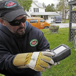 In this May 6, 2009 file photo, watt-hour meters track electricity used by residents of an apartment building in St. Marys, Pa., Wednesday, May 6, 2009. Home efficiency measures such as installing new windows or replacing insulation may actually cost homeowners money in the long run, according to the surprising conclusion of a University of Chicago study released Tuesday, June 23, 2015.