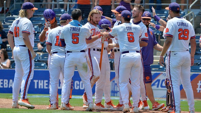 Clemson outfielder Reed Rohlman (26) is congratulated by his teammates on his second home run during game nine of the 2016 ACC Baseball Tournament in Durham, N.C., Friday, May 27, 2016. (Photo by Sara D. Davis, the ACC.com)