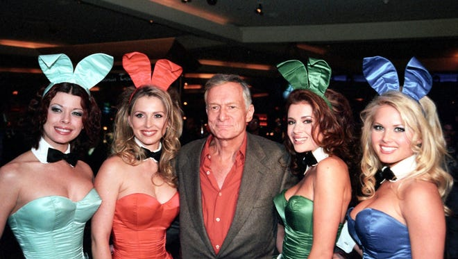 Hefner poses with Playboy Bunnies at the Hard Rock Hotel in Las Vegas in March 2001.
