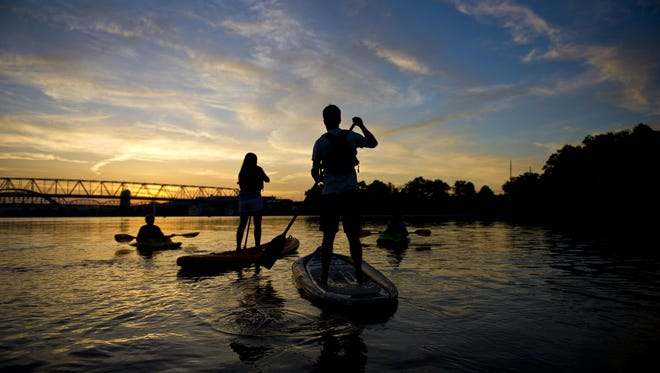 Kayakers on the Ohio River for an early morning paddle to kick off Paddlefest 2013.