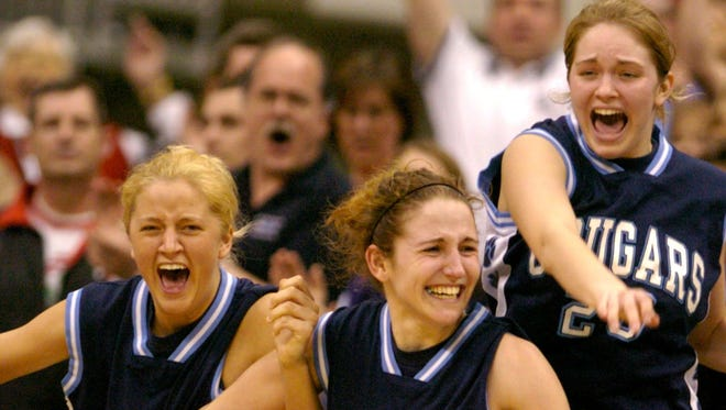 MARCH 20, 2004. Mt. Notre Dame players, from left, Cassie Brannen, Mel Thomas and Angela Estes celebrate their win over Chaminade-Julienne in the state championship game of the Ohio High School Athletic Association Division I Girls State Basketball Tournament played Saturday March 20, 2004 at Value City Arena at the Jerome Schottenstein Center on The Ohio State University campus in Columbus, Ohio. Cincinnati Enquirer photo by Gary Landers