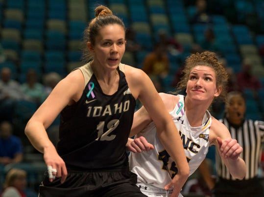 Idaho'sNejra Solo (12) and Northern Colorado's Bridget Hintz (44) fight over a rebound in the first half of an NCAA college basketball game in the championship of the Big Sky Conference in Reno, Nev., Saturday, March, 10, 2018. (AP Photo/Tom R. Smedes)