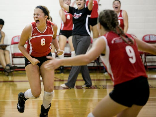 Port Huron senior Brittany Goodwin celebrates scoring a point during a volleyball game Tuesday, September 8, 2015 at Port Huron High School.