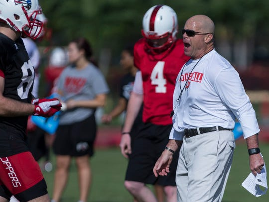 WKU interim head coach Nick Holt yells at players during the team practice at St. Andrew's School on Saturday, Dec. 17, 2016.