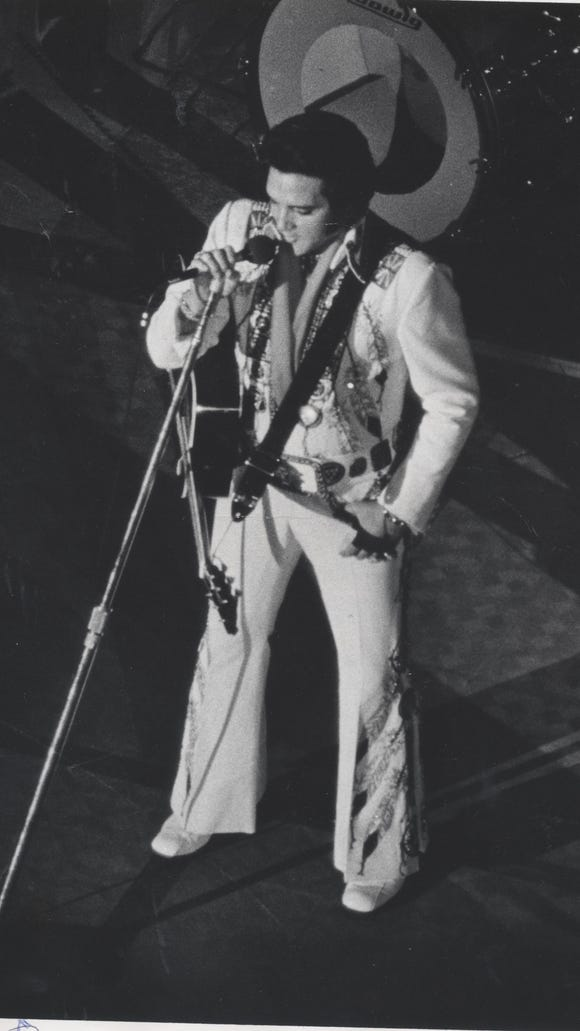 ELVIS PRESLEY IS PHOTOGRAPHED AS HE PERFORMED DURING A THREE-NIGHT CONCERT IN 1975 AT THE ASHEVILLE CIVIC CENTER. PRESLEY'S THREE CONCERTS IN 1975 PACKED THE CIVIC CENTER EACH NIGHT.  WHILE IN ASHEVILLE, PRESLEY'S ENTOURAGE WAS HOUSED IN A LARGE BLOCK OF ROOMS AT THE RODEWAY INN, WHICH WAS LOCATED ON U.S. 70.   FLASHBACK COLUMN- AUG. 16, 1992