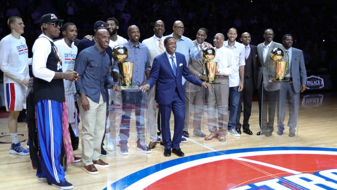Former Pistons pose with the championship trophies during halftime of final game at the Palace of Auburn Hills the Wizards on April 10, 2017.