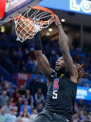 Los Angeles Clippers' Montrezl Harrell (5) dunks against Oklahoma City Thunder during the first half of an NBA basketball game in Oklahoma City, Tuesday, March, 3, 2020. (AP Photo/Garett Fisbeck)