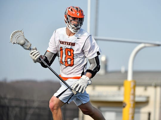 Central York's Alex Kilgour drives against Dallastown in the first half of a YAIAA boys' lacrosse game Friday, April 13, 2018, at Central York. Central York defeated Dallastown 10-8 to maintain the Panthers' so-far undefeated season record.