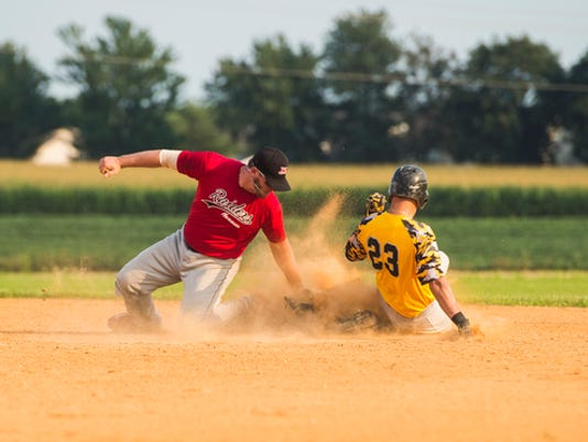 Brushtown's Tyler Meckley slides to second base as Hanover's Clint Roche goes for the tag during Tuesday's South Penn League semifinal series.
