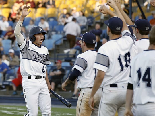 Dallastown's Nick Parker (21) celebrates with teammates after scoring against Governor Mifflin during 3rd inning action of the PIAA District 3 6A Baseball Championships at First Energy Stadium in Reading Thursday June 1, 2017.