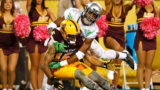 Arizona State receiver Devin Lucien (15) can't bring down a touchdown pass with pressure from Oregon defender Tyree Robinson in the first half during a Pac-12 game on Oct. 29, 2015, in Tempe.