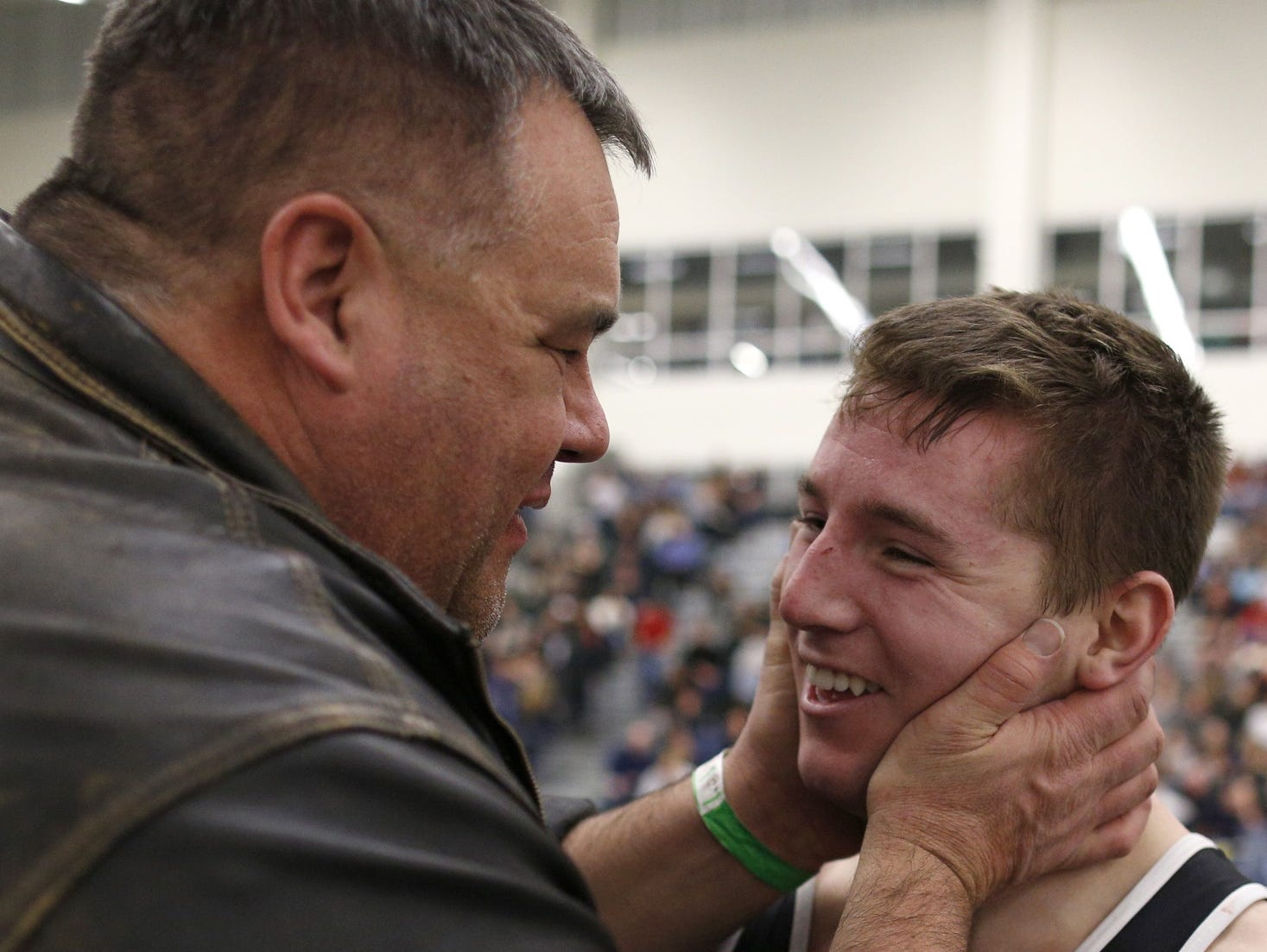 """Brad Paddock, shown here congratulating former Warsaw wrestler Ryan Coveny during the 2014 SuperSectionals, is remembered as an """"incredible mentor,'' a motivator and someone with integrity by friend Robert Hirsch."""