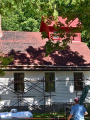 The deteriorating asphalt shingles were in dire replacement