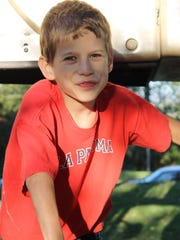 In 2012, Kyle Plush, then a fifth grader, climbed on one of the Alms Park playground structures during the Mercy Montessori fifth grader spent an evening with fellow students and families at the school' Fall Family Picnic in Mt. Lookout.