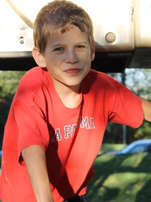 In 2012, Kyle Plush  climbed on one of the Alms Park playground structures. The Mercy Montessori fifth grader spent an evening with fellow students and families at the school's Fall Family Picnic in Mt. Lookout.
