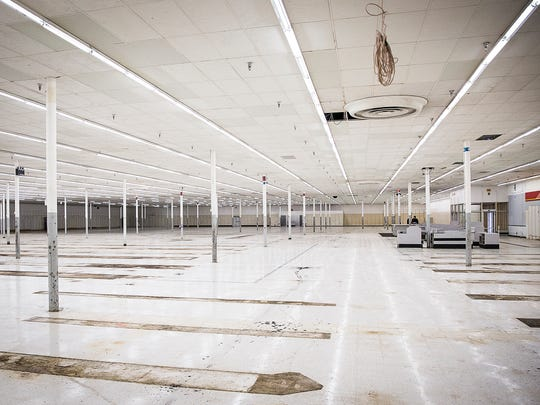 The former Kmart on McGalliard Road stands empty Thursday