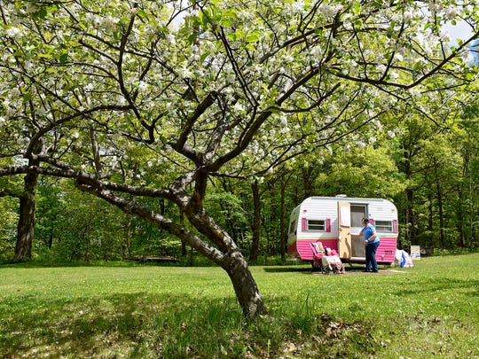 Sue Notch opens the door of her camper Celia Rose Tuesday, May 17, at her home near Avon.