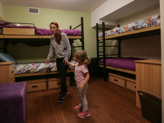 Allie Ward 27 of Grand Blanc is pulled around by her 2-year-old daughter, Aubree Allen-Ward, while looking over their new room at the Grace Centers of Hope's new Women and Children's Center in Pontiac on Monday May 16, 2016. 'I'm very thankful honestly because if I wouldn't have had this I would have been on the street and I would have lost my daughter,' Ward said. Ward became hooked on pain killers after having multiple surgeries following her grandmother's death that lead her to becoming a heroin addict. 'These people are giving me a chance to be who I'm capable of.'