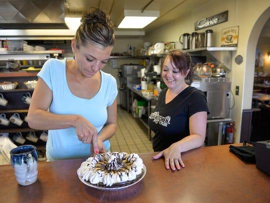 Tanya Finken, left, owner of Kay's Kitchen, and server Brenda Heaton cut up a slice of Elvis pie July 22, 2016, at the St. Joseph restaurant
