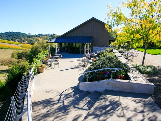The tasting room at WillaKenzie Estate includes a large tiered patio. The estate was recently sold to Jackson Family Wines, which now owns over 500 acres of vineyards across the Willamette Valley.