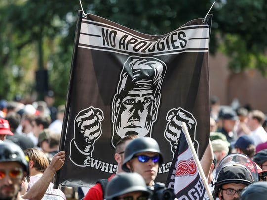 A modified Detroit Red Wings logo with the spokes that were altered to look like swastikas appeared at a white supremacist rally in Charlottesville, Virginia on Saturday, Aug. 12, 2017.