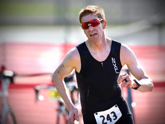 Jesson Baumgartner of Rochester was the men's division champion of the 2018 Apple Duathlon in Sartell. He finished in 1 hour, 21 minutes, 16 seconds. Participants run a 5-kilometer road race, then bike 33 kilometers before finishing with a 5K run.