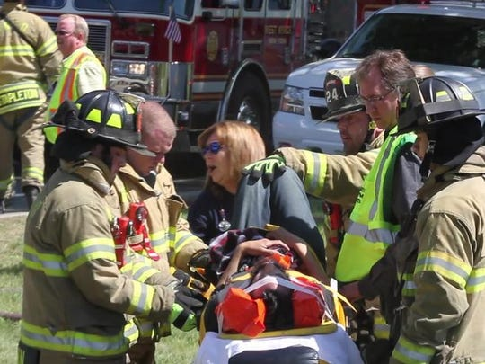 Emergency personnel respond to fatal crash on Route 303 outside the Palisades Center mall in May.