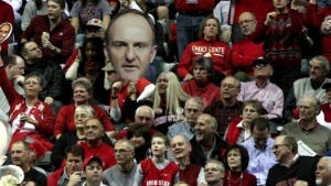 Ohio State fans are seen in the stands in the first half of an NCAA college basketball game in the second round of the Big Ten Conference tournament in Indianapolis, Friday, March 9, 2012.