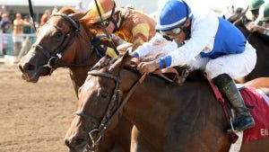 Molly Morgan and Jesus Castanon held off the late-running Tapit's World to win Ellis Park's Grade III Gardenia. Coady Photography
