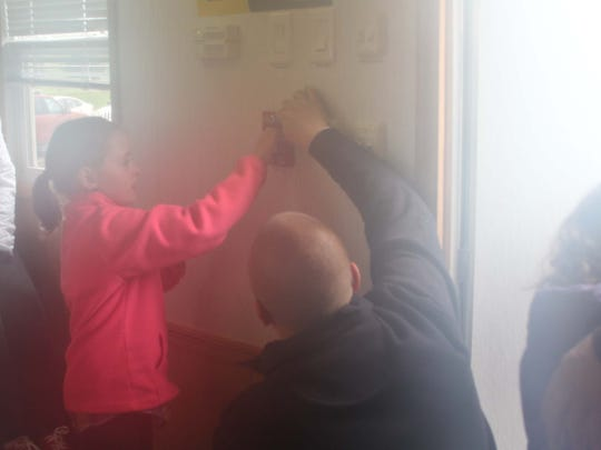 Country Elementary School students were given an opportunity to pull a fire alarm during a mock kitchen fire in May. The exercise was part of Hamburg Township Fire Department's fire safety education program.