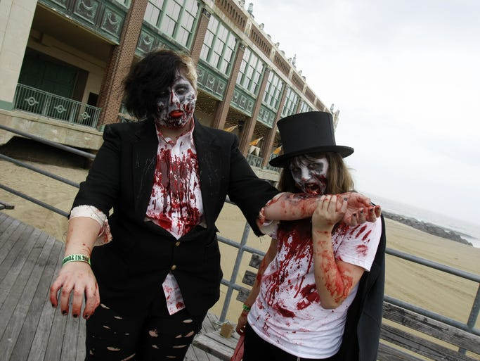 Amanda Doughty, Norwich, CT, left, and Danielle Foreman, Manalapan, walk the Asbury Park Boardwalk in full zombie costumes before the start of the 2009 Zombie Walk in Asbury Park.