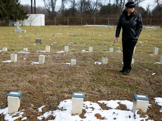 Susan Gregg-Feher turns around to take a last look at where her mentally disabled brother is buried at Potters Field Cemetery despite her instructions to the Medical Examiner that she wanted her brother buried at their family plot in Hockessin.