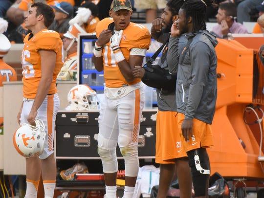 Tennessee quarterback Joshua Dobbs,center, linebacker Jalen Reeves-Maybin and running back Alvin Kamara talk on the sideline during the game against Tennessee Tech on Nov. 5, 2016, at Neyland Stadium.