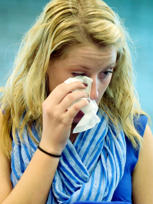 "Spring Grove High School graduate Kaci Dennis of North Codorus Township wipes a tear while listening to the parents of her cousin, Ashlyn Stambaugh, speak during a press conference at the school Tuesday, Nov. 9, 2015. Ashlyn was killed last March in a car accident caused, according to her family, by her texting and driving. The family was there to launch the ""Here...but driving"" campaign which addresses the texting and driving. Bill Kalina - bkalina@yorkdispatch.com"