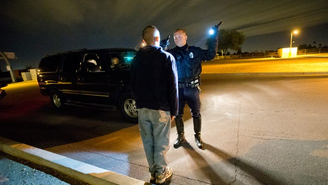 Mesa police officer Christopher Beauford checks for signs of impairment in an enforcement operation in December, 2013. This tests indicated the driver was not impaired and he was allowed to leave.
