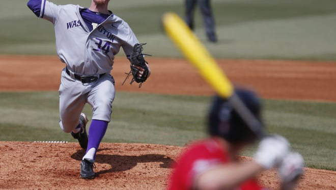 Washington pitcher Jeff Brigham (34) pitches to a Mississippi batter in the first inning of an NCAA college baseball regional tournament game in Oxford, Miss., Sunday, June 1, 2014. (AP Photo/Rogelio V. Solis)