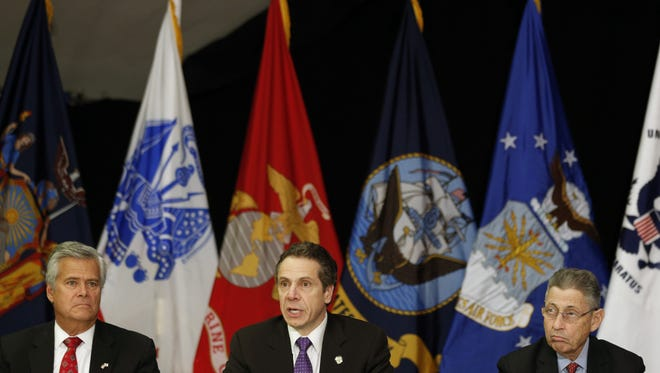 New York Gov. Andrew Cuomo, center, speaks during a Veterans and Military Families Summit as Senate Republican leader Dean Skelos, R-Rockville Centre, left, and Assembly Speaker Sheldon Silver, D-Manhattan, listen in the Hart Lounge on Thursday in Albany.