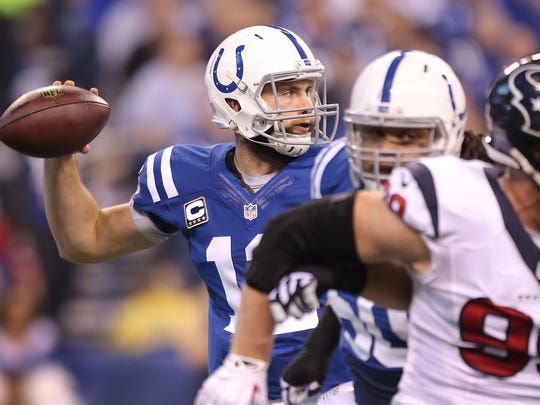 Indianapolis Colts quarterback Andrew Luck (12) drops back to pass in the second half of their game Sunday, December 14, 2014, afternoon at Lucas Oil Stadium. The Colts defeated the Texans 17-10 to win the AFC South.