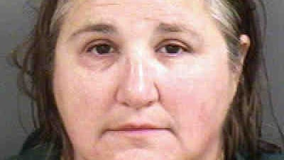 Deborah Moulton was charged with obstruction of justice after deputies said her husband, Robert Moulton, 61, shot their neighbor to death May 4 in North Naples.