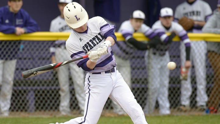 Lakeview's Zach Dehn (2) prepares to swing as he gets a base hit during game action Wednesday night as the Spartans face off against the Pennfield Panthers.